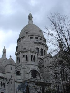 Photo of cathedral of gray stone with domed towers