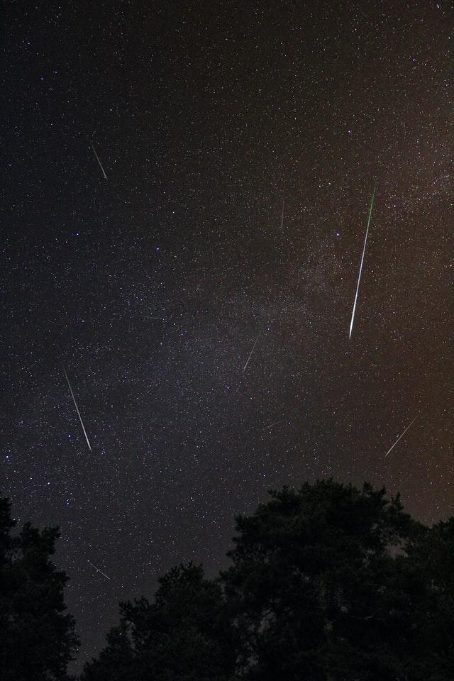 Meteors streaking across a starry sky