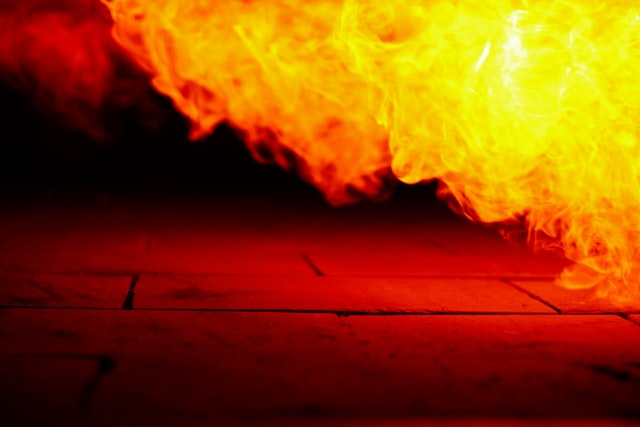 A gout of yellow flame emerging from a furnace